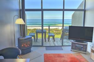 A television and/or entertainment center at A Great Ocean Road Resort Whitecrest.