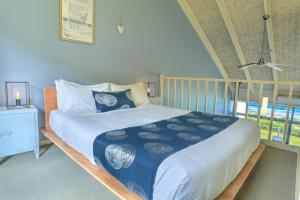 A bed or beds in a room at A Great Ocean Road Resort Whitecrest.