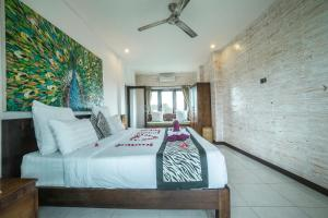 A bed or beds in a room at Iman Homestay Ubud