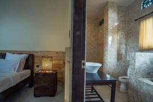 A bathroom at Iman Homestay Ubud