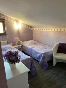 A bed or beds in a room at Gite de la Streng