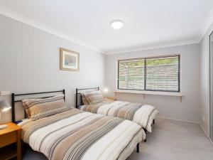 A bed or beds in a room at Villa 125 'Horizons' 5 Horizons Drive
