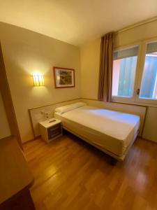 Cama o camas de una habitación en Hotel Estel