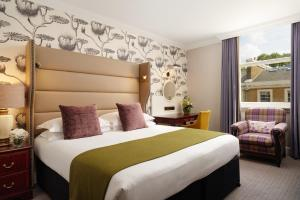 A bed or beds in a room at The Bailey's Hotel London