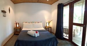 Cama o camas de una habitación en V.VILLAS
