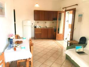 A kitchen or kitchenette at Porto Kassiopi Apartments