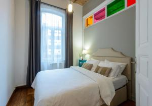 A bed or beds in a room at Stay Istanbul Apartments