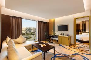A seating area at Pride Plaza Hotel, Aerocity New Delhi