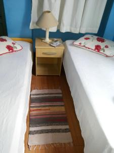 A bed or beds in a room at Hotel Juliz