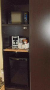 A kitchen or kitchenette at Park Inn & Suites by Radisson