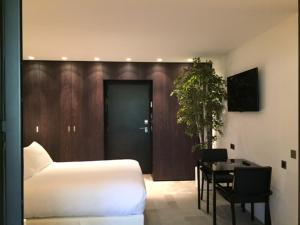 A television and/or entertainment center at Bdesign & Spa