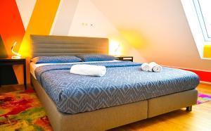 Postel nebo postele na pokoji v ubytování Bright Apartment Naschmarkt