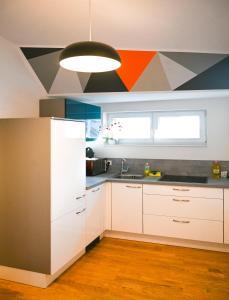 Kuchyň nebo kuchyňský kout v ubytování Bright Apartment Naschmarkt