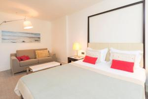 A bed or beds in a room at Amfora Hvar Grand Beach Resort