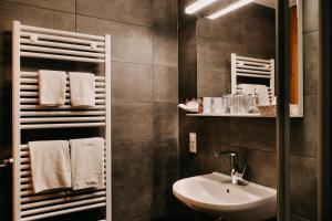 Ein Badezimmer in der Unterkunft Badischer Hof