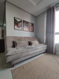 A seating area at Apartamento novo com 2 dormitórios no centro de Passo Fundo