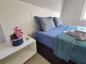 A bed or beds in a room at Apartamento novo com 2 dormitórios no centro de Passo Fundo