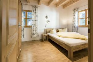Ein Bett oder Betten in einem Zimmer der Unterkunft Zugspitzpanorama