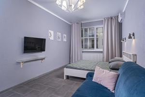 A television and/or entertainment centre at Premium апартаменты на первой береговой линии
