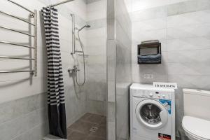 A bathroom at Premium апартаменты на первой береговой линии