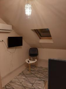 Un televizor și/sau centru de divertisment la Pension Mellis Cluj Napoca