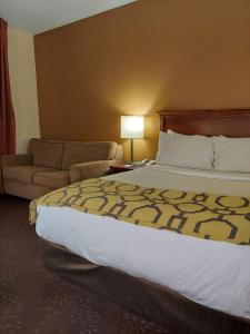 A bed or beds in a room at Baymont by Wyndham Portage