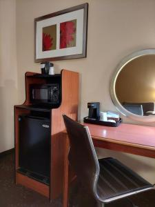 A television and/or entertainment center at Baymont by Wyndham Portage