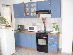 Kuchyň nebo kuchyňský kout v ubytování Apartment Goran