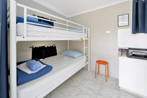 A bunk bed or bunk beds in a room at BIG4 Cane Village Holiday Park