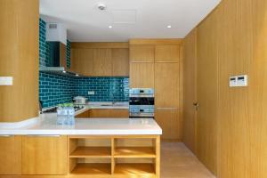 A kitchen or kitchenette at Albion Residence Haitang Bay Sanya