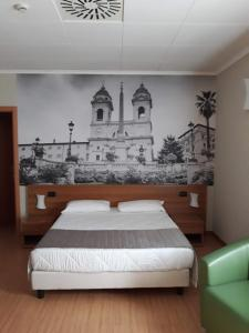 A bed or beds in a room at Ele Green Park Hotel Pamphili
