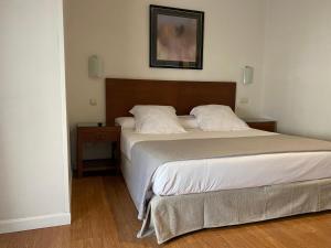 A bed or beds in a room at Rincón de Gran Vía