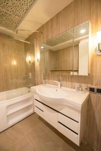 A bathroom at Centaurus Hotel Apartments