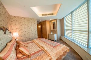 A bed or beds in a room at Centaurus Hotel Apartments