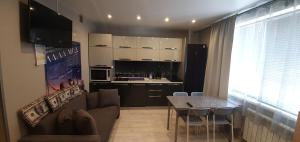 A kitchen or kitchenette at Apartment with Terrace
