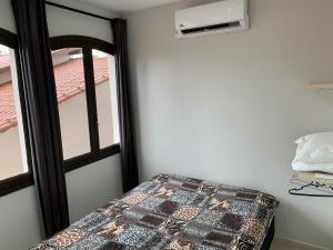 Cama ou camas em um quarto em Apartamento Jangada