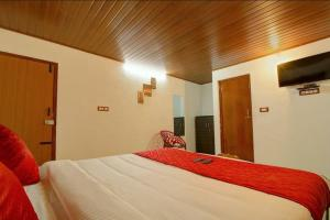 A bed or beds in a room at Coorg Hill View Stay