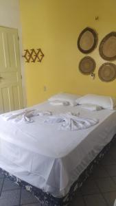 Cama ou camas em um quarto em Hotel Pilão