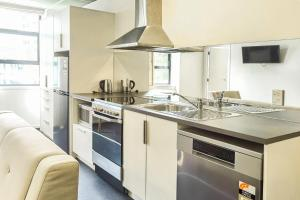 A kitchen or kitchenette at Park Hotel Lambton Quay