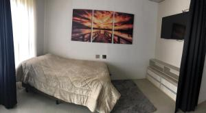 A bed or beds in a room at Apto Moderno na Praia Brava