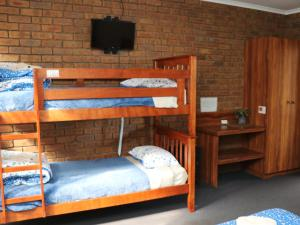 A bunk bed or bunk beds in a room at Bellum Hotel