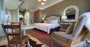 A bed or beds in a room at On the Beach Guesthouse Jeffreys Bay