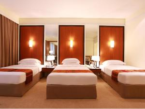 A bed or beds in a room at Dusit Princess Chiang Mai