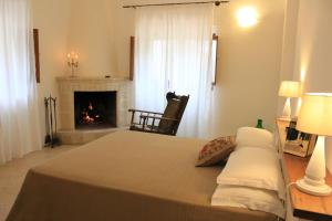Letto o letti in una camera di Masseria Zambardo