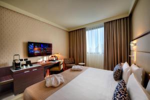 Ein Bett oder Betten in einem Zimmer der Unterkunft Aemilia Hotel Bologna