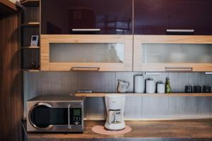 A kitchen or kitchenette at Fotuso House