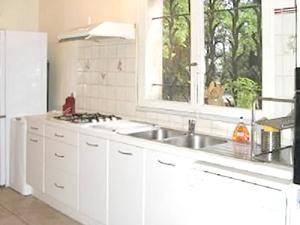 A kitchen or kitchenette at House with 4 bedrooms in Cucuron with private pool furnished garden and WiFi