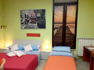 A bed or beds in a room at Apartment with one bedroom in Nocera Superiore with balcony and WiFi 7 km from the beach