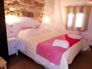 A bed or beds in a room at Apartment with one bedroom in Cinisi with WiFi