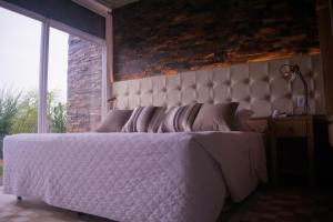 A bed or beds in a room at Pousada Cantelli